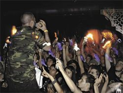 Audience members illuminate the show while Grime plays &quot;On the White House Lawn.&quot;