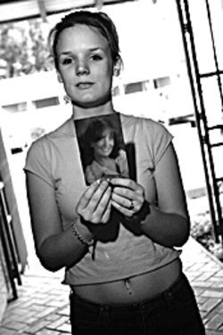 Jennifer Braillard holds a photo of her late mother,  Deborah, whom Arpaio's guards let collapse into a  diabetic coma while incarcerated.