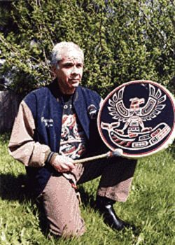 Makah whaling captain Wayne Johnson strikes his family drum commemorating the successful May 17, 1999, hunt.