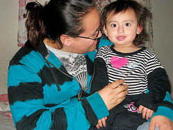 Vasquez's wife, Karla, with their daughter Samy.