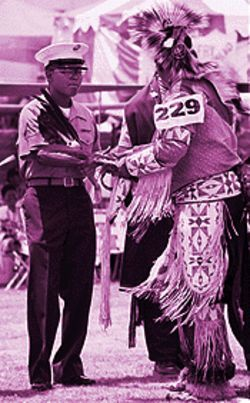 A native soldier greets a tribesman in more traditional garb.