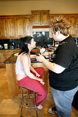 A makeup artist prepares Taryn Thomas for a shoot in the kitchen of the  Scottsdale home that doubles as a porn studio.