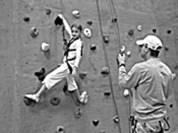 Rockin': Kids scale the walls at AZ on the Rocks for family night.