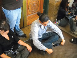 College students chained to the state Capitol's doors.