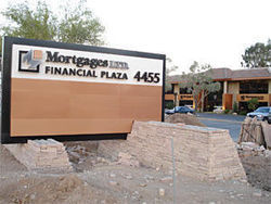 The sign at Mortgages Ltd.&#039;s brand-new office complex on Camelback Road near 44th Street. Construction continued on the high-end office building, even as the company ran out of money to fund its loan commitments.