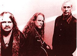 Liver than you'll ever be: Gov't Mule (from left), Allen Woody, Warren Haynes and Matt Abts.
