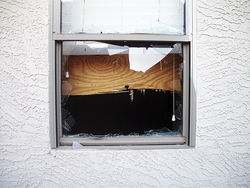 Kidnappers nailed sheets of plywood over the windows of this west Phoenix home to keep hostages from escaping.