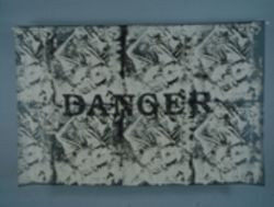 Danger, 1997. English/Spanish dictionary laminated onto fabric.