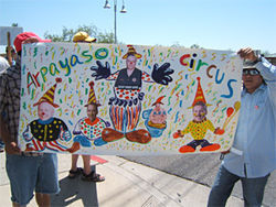 "A demonstrator's depiction of ""Arpayaso's Circus,"" payaso being Spanish for ""clown."""