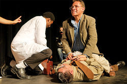 That's me (to the right, grimacing), as portrayed by Jerry Mendoza, performing CPR on a certain corrupt top cop during James Garcia's American Pastorela: The Saga of Sheriff Joe.