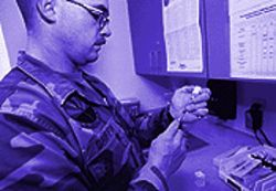 Staff Sergeant Anthony Griffin prepares a syringe of the anthrax vaccine. The Pentagon wants all 2.4 million members of the military to receive anthrax shots.