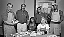 Juba-lation: The Juba team, from left, standing: Mike Eldeleymi, Middle Eastern and Mediterranean chef; Abdulahi Hussein, co-owner; Mohamed Ali, co-owner; Musa Warsame, Somalian chef. Seated: Ayan Mohamed, waitress (left), and Aracely Aispuro, kitchen assistant.