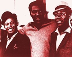 Sam and Dave, all smiles with friend and tourmate Otis Redding (center).