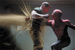 Pounding sand: Spidey gives it to one of three baddies.