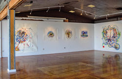 A gallery shot at Modified Arts featuring, at left, Southern Cross (2012) and Wouldn&#039;t He Remember His First Home? What Passed for Wisdom There? (2011), on right.