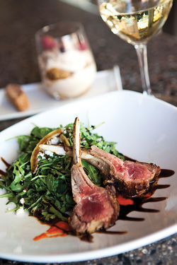 Lamb chops are one of the dishes cooked in the wood-fired oven at Timo, in Sunnyslope.