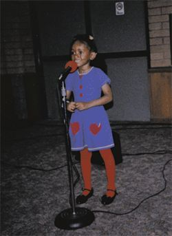 An even younger Ashlee Byrd gets comfortable behind the mic.