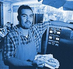 Hernan Rivera sees his hot dog stand as a step toward owning a restaurant.