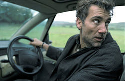 Clive Owen tries to escape his pursuers in Children of Men.