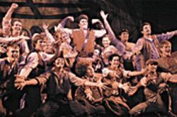 Chorus boys galore get gassed up on Gaston in Disney's Beauty and the Beast.