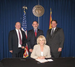 (From left) Todd J. Rathner, Knife Rights Chairman Doug Ritter, Governor Jan Brewer, and state Senator Chuck