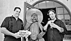 Gregarious gourmets: Chef Carlos Manriquez (left) holding his clams adobo, and his partner Chad Withycombe enjoying one of Mucho Gusto's marvelous margaritas.