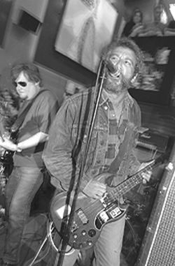 I just Watt to be your dog: Mike Watt and Ron Asheton act like the Stooges during a Tower Records in-store.