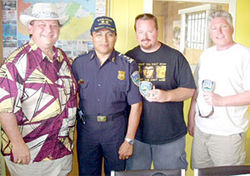 Honduran high jinks: (from left) MCSO Chief Deputy Dave Hendershott, Honduran police official Julio Benitez, retired MCSO deputy Roger Marshall, and MCSO Captain Jim Miller.