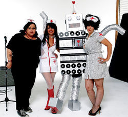 "The Cosmeticators pose with ""Roboman."""