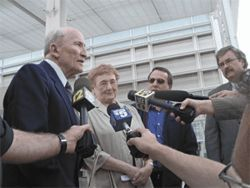From left, Charles and Carol Agster, along with son, Larry, answer questions following the verdict.