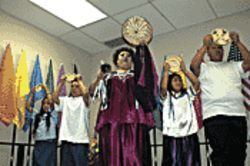 Angel Manuel (center) performs a traditional Tohono O'odham ritual, flanked by her siblings, at the Miss Native American Transgender Beauty Pageant.