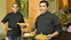 Currying favor: Executive chef Talwinder Dhaliwal (right) and chef Keshav Kandel show off some of the The Dhaba's Punjabi specialties.