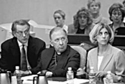 In the courtroom: Bishop O'Brien flanked by defense  attorneys Patrick McGroder and Melissa Berren.