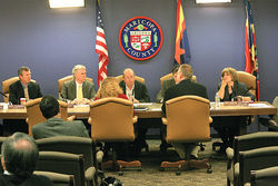 Discredited MACE investigations guided by Arpaio targeted three of the five county supervisors -- Andy Kunasek and Don Stapley (both left of U.S. flag) and Mary Rose Wilcox (right). The poorly evidenced cases fell apart, leading to accusations of political wrongdoing by Arpaio and former County Attorney Andrew Thomas.