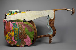 World of sound: The star harp fuses harp, guitar, marimbula, and square-frame drum into one instrument.