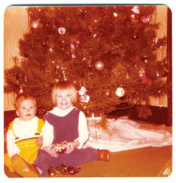 The author (left) and her big sister celebrate the Christmas of 1977.