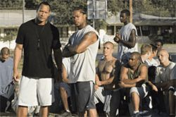 "Football is life: Dwayne ""The Rock"" Johnson (left) and Xzibit prepare a team of inmates for battle in Gridiron Gang."