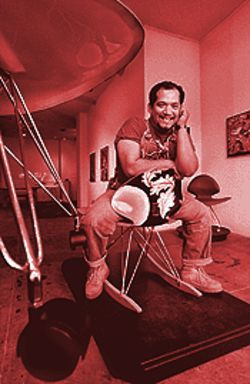 "Artist/curator Ralph Cordova at the MARS Gallery in the Central Building (seated on a piece of artwork by Mike Hovey): ""I love the nooks and crannies in this place."""
