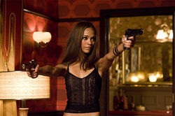 Sexpot with a gun: Zoe Saldana gets little to work with as Aisha in The Losers.