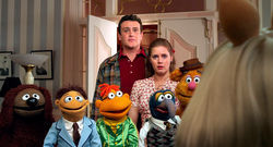 Labor of love: Jason Segel, Amy Adams, and the gang in The Muppets.