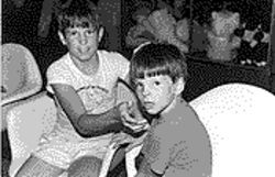 Mark Kennedy (left) at age 12, with a nephew.