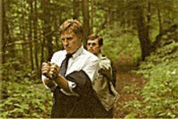 Wayne Hayes (Robert Redford) heads into the forest with his kidnapper (Willem Dafoe) in The Clearing.