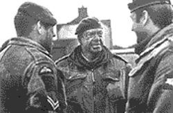 Simon Mann (center) was an actual British army soldier in 1972. He portrays British Colonel Wilford in Bloody Sunday.
