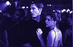 Mia (Amanda Peet) has Brad (Brian Van Holt) and his two friends pining for her beautiful, really big teeth in Whipped.
