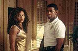 Time bomb: Sanaa Lathan and Denzel Washington are implausibly cast as former high school sweethearts in Out of Time.