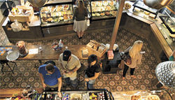 See food restaurant: Customers browse the offerings at The Foodbar.
