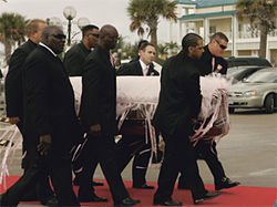 Funeral fit for a princess: Pallbearers carry SmithÂ's mahogany casket, draped in rhinestone-studded silk.