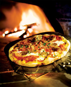 Old-fashioned wood-fired pizzas and a relaxed atmosphere have made Tommy V&#039;s Osteria Pizzeria a popular new spot on Camelback.