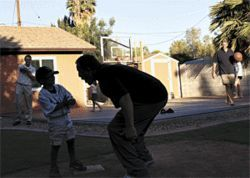 Murphy sticks the needle -- playfully this time -- into his 5-year-old son Kai at his Tempe home.