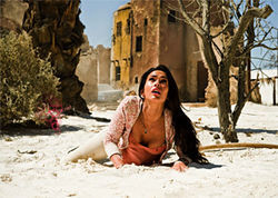 Weirdly too hot: Megan Fox watches the destruction in Transformers 2.